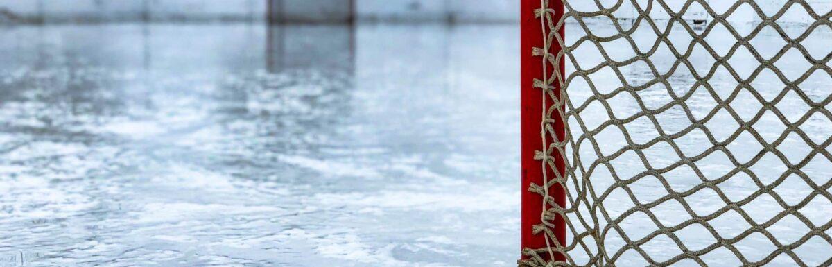 Hockey net on an empty, outdoor rink