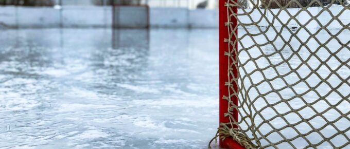 Hockey net on an empty, outdoor rink