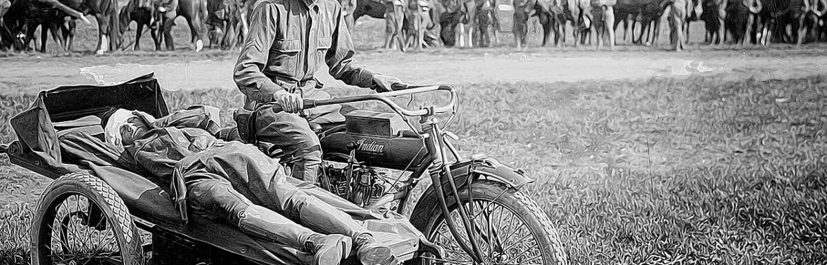 Soldier carrying another injured soldier in sidecar of a bike