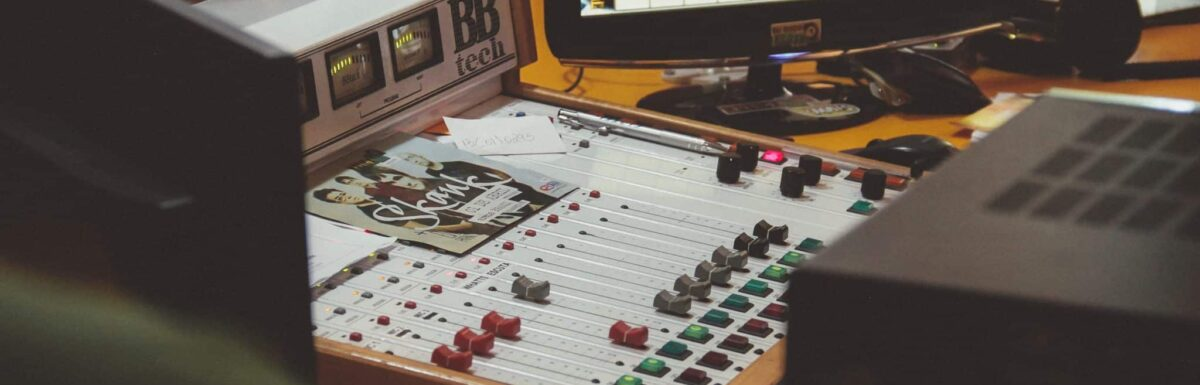A radio station mixing board and computer