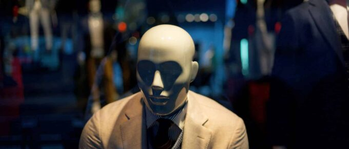 A male mannequin in a white suit