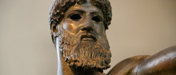 Ancient bronze statue of a Greek god