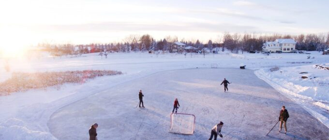 Photo of hockey players on a frozen pond