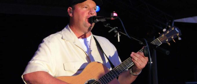 Musician Christopher Cross playing guitar