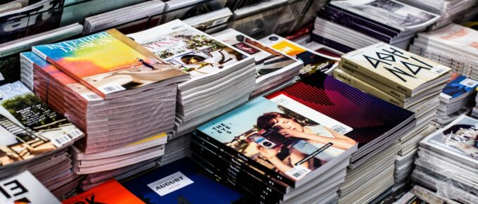 Piles of magazines at store