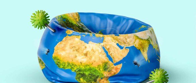 Image of a deflated globe, pricked by pins representing coronavirus
