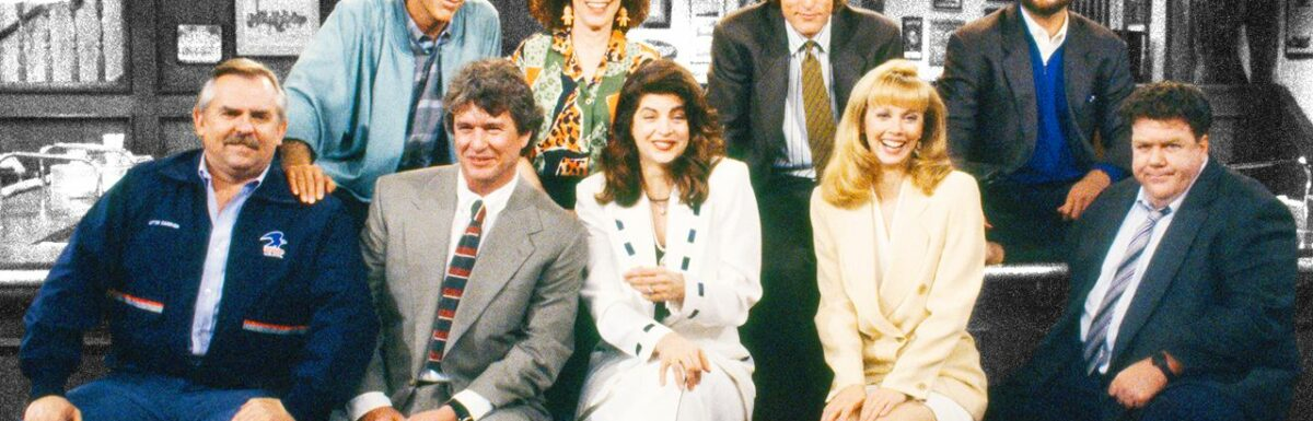 The cast of the sitcom Cheers pose in the bar