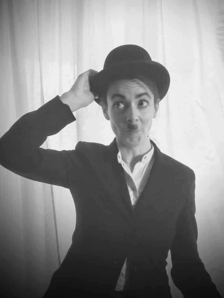 Photo of co-editor Janet Mowat dressed as Chaplin or maybe she just looks like that
