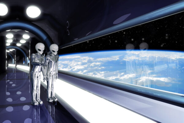 Aliens standing near a window in their UFO, looking at earth
