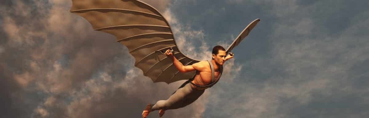 Man flying through sky on artificial wings