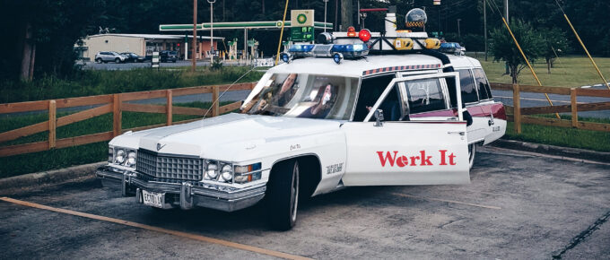 The car from Ghostbusters, with Sam and Janet Photoshopped into the window and a Work It decal on the site