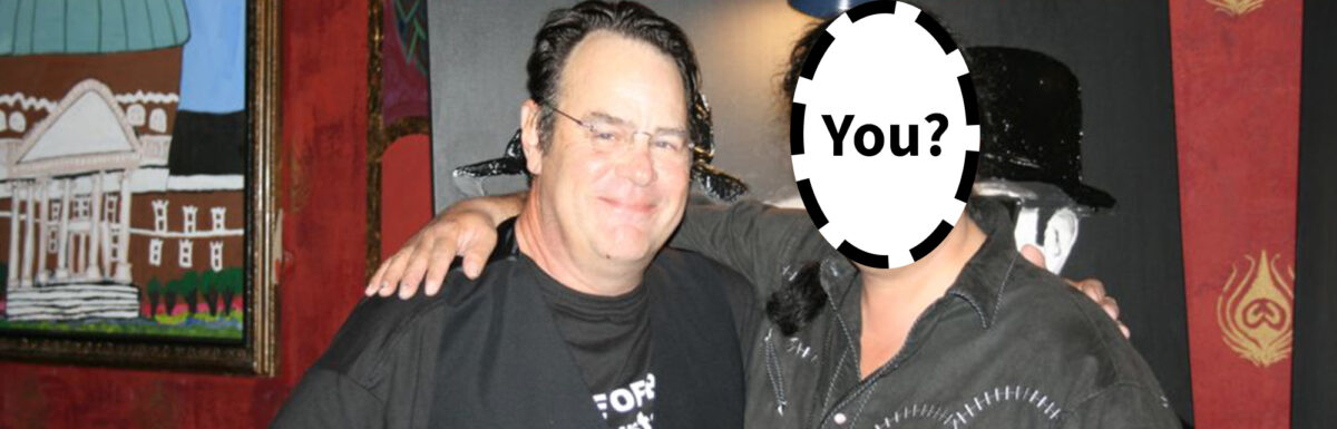 """An image of Dan Aykroyd with a second person whose face is 'blanked' out and it says """"You?"""" over top"""