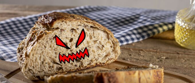 A loaf of bread with cartoonish evil face
