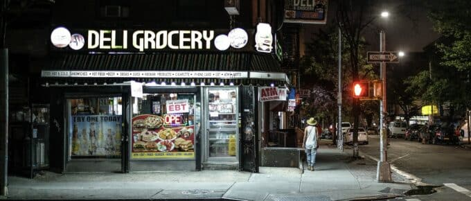 NY deli exterior at night