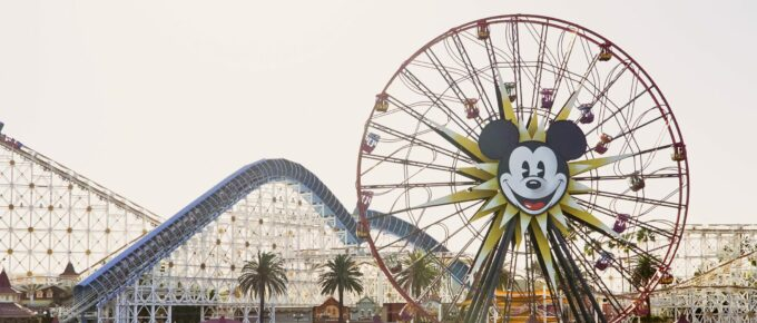 Roller coaster emblazoned with Mickey Mouse's face at a Disney theme park
