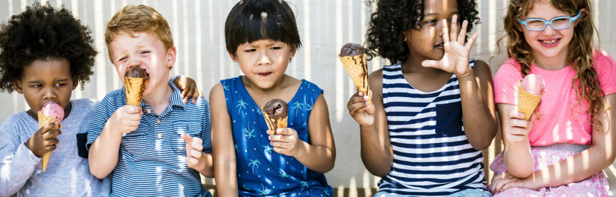 Kids eating ice cream in the summer