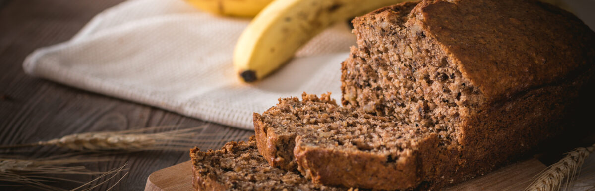 Fresh banana bread on rustic background