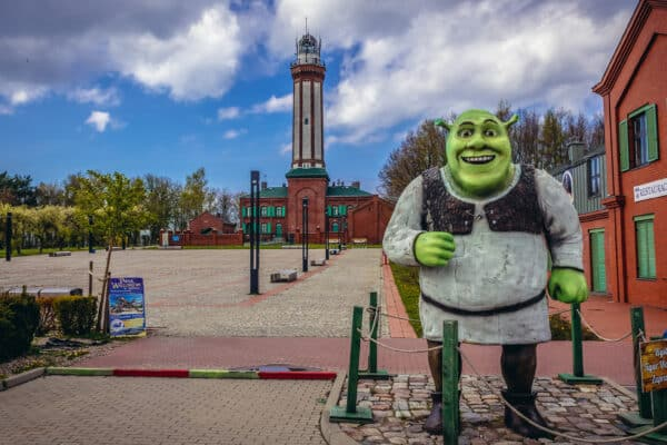 Shrek figure on the square in front of lighthouse in Niechorze, small village on the Baltic Sea coast