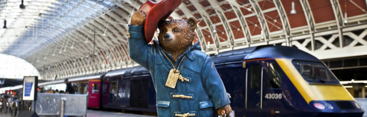 LONDON, UK - NOVEMBER 4TH 2014: A sculpture of Michael Bond's fictional children's character Paddington Bear - situated in Paddington Station in London on 4th November 2014. This is one of 50 designs located across London through out November and December in celebration of the release of Paddington the movie.