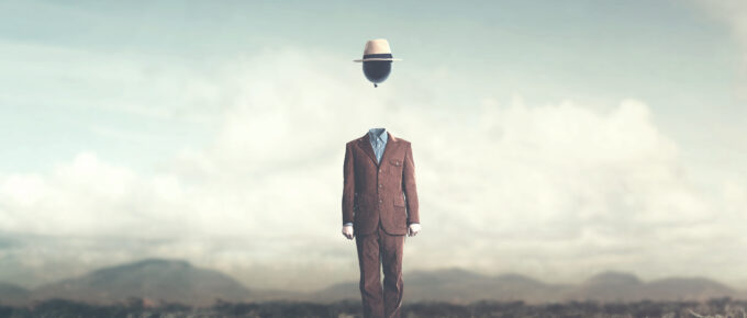surreal minimalist man with big black balloon suspended over his head