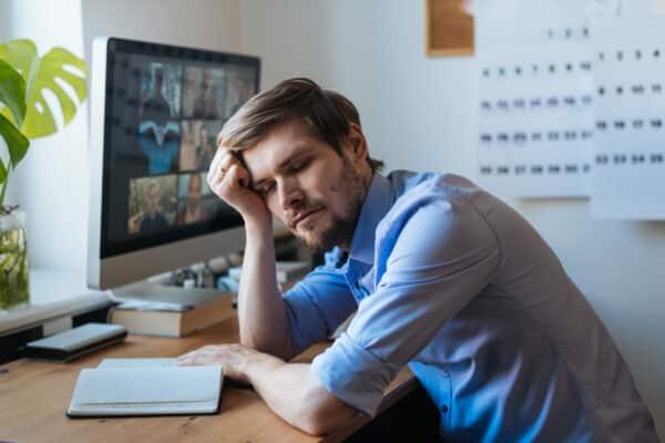 Man sleeping near computer with Zoom on it