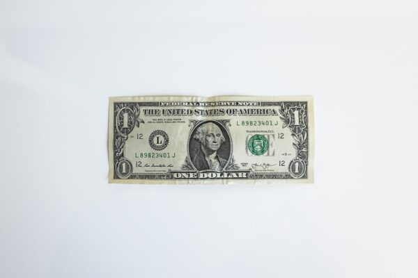 A single US dollar bill on a white background