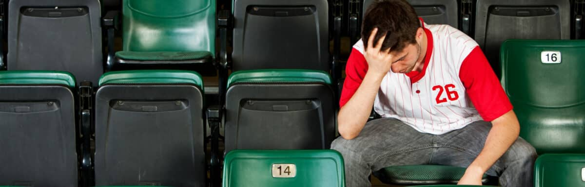 Fans: Man Sits Alone After Losing