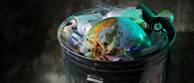 Trash can with earth and rubish