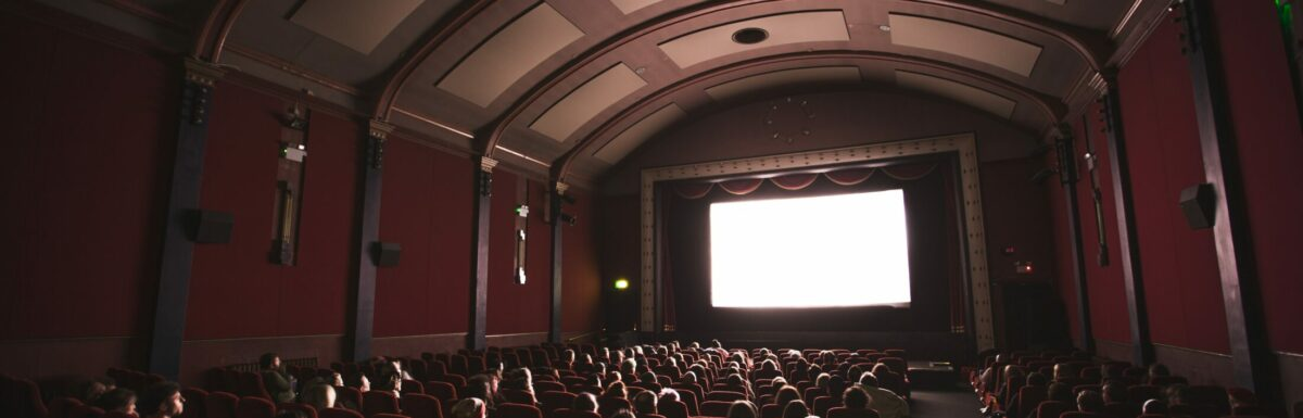 People sitting in a movie theatre