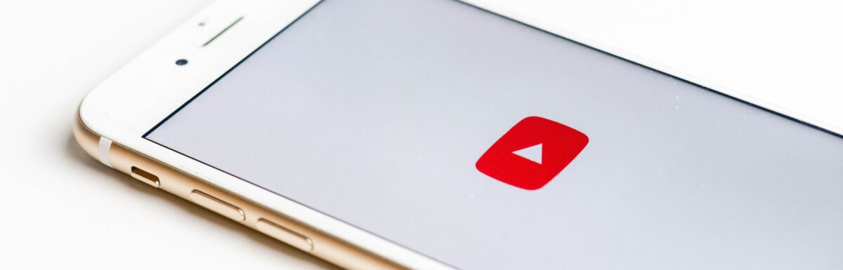 Mobile phone with YouTube logo on screen